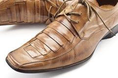 коричневые ботинки людей s Стоковые Изображения