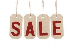 4 коричневых бирки с продажей слова Стоковое Фото