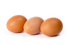 3 коричневых яичка цыпленка на белизне Стоковые Фотографии RF