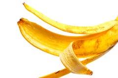 Корка банана на белой предпосылке Стоковое фото RF