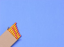 Коробка карандаша на голубой предпосылке Стоковые Фото