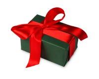 Коробка праздничного подарка рождества в зеленой книге изолированной на белизне Стоковые Фотографии RF