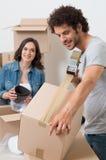 Коробка упаковки человека с Sellotape Стоковые Изображения RF