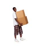 Коробки нося молодого Афро-американского мужчины Стоковое Изображение RF