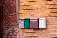 4 коробки почты в ряд Стоковые Изображения