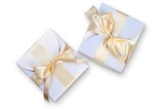 2 коробки с смычком золота Стоковые Изображения RF