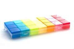 Коробочка для таблеток на белой предпосылке Стоковое Изображение RF