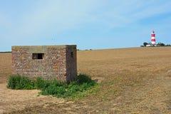 Коробочка для таблеток WW2 & маяк Happisburgh, Норфолк, Великобритания Стоковые Изображения RF