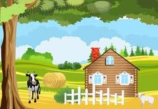 Корова около дома в деревне, сельская местность, обрабатываемая земля, тема земледелия стоковое изображение
