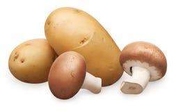 2 королевских гриба champignon и unpeeled картошки Стоковые Изображения