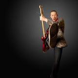 коромысло гитары ноги Стоковая Фотография