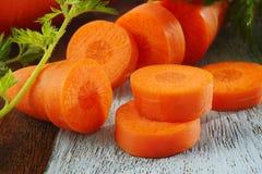 Короткая морковь на деревянной предпосылке Стоковые Изображения