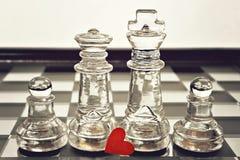 Король, ферзь и пешки на шахматной доске Стоковая Фотография