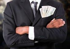 Коррумпированный бизнесмен с деньгами в карманн Стоковое фото RF
