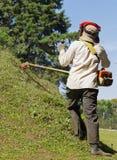 Косить лужайку холма Стоковые Фотографии RF