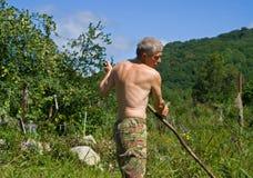 косить человека 33 трав Стоковые Изображения RF
