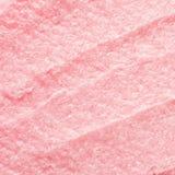 Косметика текстуры scrub для сахара стороны и тела розового Селективный фокус, ультрамодная напористая пастельная предпосылка стоковая фотография