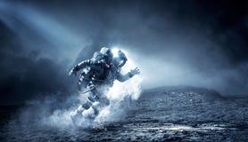 Космонавт бежать быстрое мультимедиа стоковые изображения