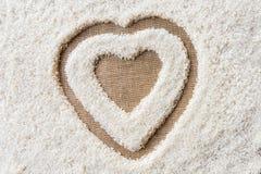 Космос предпосылки риса в середине сердца Стоковое Изображение