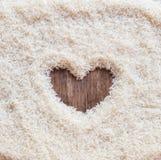 Космос предпосылки риса в середине сердца Стоковое Фото