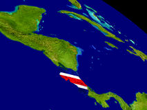 Коста-Рика с флагом на земле Стоковое фото RF