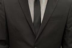 Костюм бизнесмена нося и галстук связи Стоковое Изображение