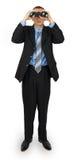 Костюм бизнесмена нося с голубой связью с биноклями Стоковое Изображение