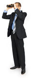 Костюм бизнесмена нося с голубой связью с биноклями Стоковое фото RF