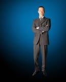 костюм бизнесмена сь стоящий стоковая фотография rf