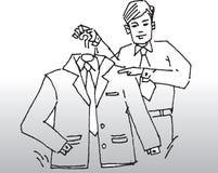 Костюм удерживания человека на вешалке Стоковая Фотография
