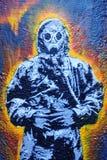костюм человека hazmat надписи на стенах Стоковое Изображение RF