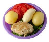 Котлета с картошками на плите Стоковое фото RF