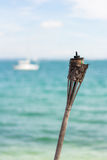 , который сгорели факел на пляже Стоковые Фото