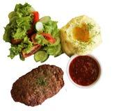 Котлета с картошками и салатом Стоковые Изображения