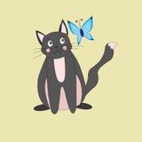 Кот и бабочка Стоковое Фото