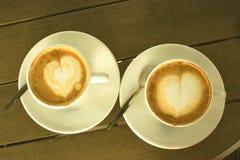 Кофейная чашка в кофейне - винтажном изображении стиля стоковые фото