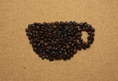 Кофейная чашка в форме кофейного зерна Стоковая Фотография RF