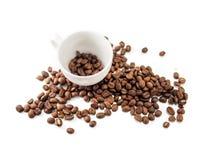 Кофейная чашка и кофейные зерна Стоковое Фото