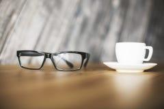 Кофейная чашка и стекла Стоковые Изображения