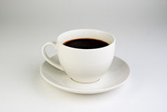 Кофейная чашка на белой предпосылке Стоковые Изображения