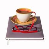 Кофейная чашка на тетради Стоковое фото RF