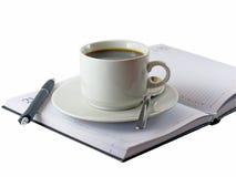 Кофейная чашка, положение на раскрытом orgazer. стоковое фото