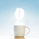 Кофейная чашка с символом кофейных зерен Стоковая Фотография
