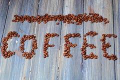 Кофейное зерно помечая буквами взгляд сверху конца-вверх дальше стоковое фото