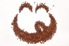Кофейные зерна аранжированные как сторона smilie Стоковая Фотография