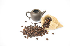 Кофейные зерна в вкладыше Стоковые Фото