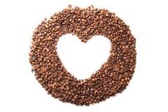 Кофейные зерна в форме изолированного сердца Стоковые Фото