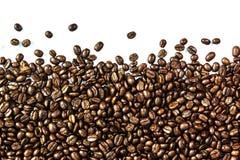 Кофейные зерна и кофейная чашка Стоковые Фото