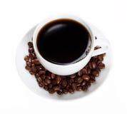 Кофейные зерна и кофейная чашка Стоковая Фотография