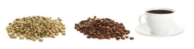 Кофейные зерна и чашка кофе Стоковое фото RF